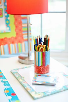 Use cans to decorate your classroom and store supplies!  www.inspiredinstyle.com