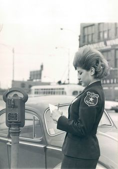 "Parking attendant. ""Chicago Meter Maid, 1966."" Shoulder sleeve patch. Miniskirt? No photographer or source cited."
