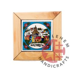 Olive Wood with Ceramic / Nazareth - The beautiful city of Nazareth is the childhood home of Jesus, St. Joseph and the Blessed Virgin Mary. It is also where the beautiful Church of the Annunciation is located. This beautiful ceramic tile of Nazareth is surrounded by fine olive wood frames, making it a great piece to own or gift to someone close. (Nazareth ceramic, Nazareth olive wood, Nazareth ceramic olive wood, olive wood ceramic, holy land ceramic, wooden frame ceramic, wooden gifts)