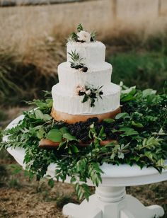 Rustic wedding cake with blackberries + greenery