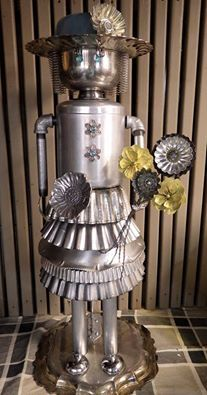 Repurposed kitchen items into a garden or flower décor item?!!  I don't even know which board to pin this too!!!  LOL.  Just cute!