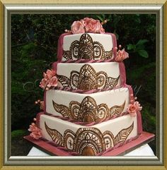 Henna cake - don't like the fondant draping on the side but do like the way the design is repeated and scaled on each tier.