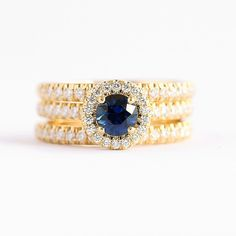 A striking yellow golden Halo ring makes this intense blue sapphire stand out even more. #Baunat #ShineYourMost #Diamonds #Engagement #EngagementRing #Gemstone #Sapphire #IntenseBlue #SapphireHalo #YellowGold #Haloring #DiamondLife #DiamondRing #Rings #18k #GiftIdeas #WeddingIdeas #Proposal #DiamondJewelry #Luxury #LuxuryLife #SolitaireRing #Design #designjewelry #CertifiedDiamond