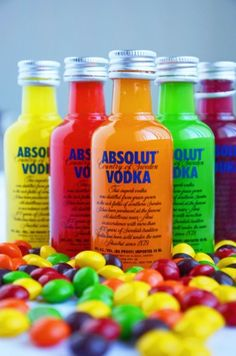 Skittles Vodka : Add separated skittles to vodka or rum bottles (take out some vodka it will overflow please realise this lol) let sit over night shake. Serve.(You can filter if left with an unwanted film on top coffee filters work fine) #Cocktails #Dinks #Alcohol