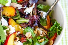 Savor the last days of summer with grilled peach, chicken, and goat cheese salad with honey white balsamic dressing