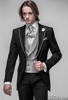 levita prenda masculina con mangas y faldones hasta la rodilla