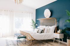 bohemian bedroom with peacock blue accent wall, teal blue, sherwin williams marea baja