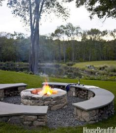 outdoor stone fireplaces - round stone fire pit encircled by stone benches - house beautiful via atticmag