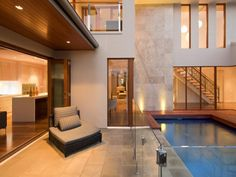 Photo of a geometric pool design using brick with verandah & decorative lighting - Pool photo Browse hundreds of photos of geometric pools & images of a verandah in pool designs. Swimming Pool Plan, Swimming Pool Photos, Custom Home Builders, Custom Homes, Salisbury Homes, Pool Images, Pool Cabana, Outdoor Tiles, Facade House
