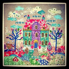 A house on the hill.  Appliqué fabric picture By lucy Levenson www.lucylevenson.com
