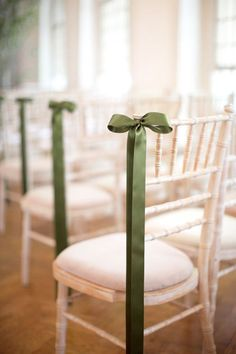 simple green ribbons decorating ceremony chairs for elegant wedding ideas