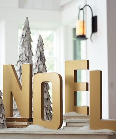 "Proclaim your passion for the season with this golden set of ""NOEL"" Letters on your mantel or sideboard."