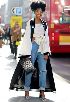 Let's take a moment to appreciate the epic coordination at play in this getup. From the peep-toes to the clutch bag to the – you guessed it – kimono, the monochrome memo is running rampant throughout this look and the bomber-meets-kimono works perfectly teamed with those true-blue mom jeans and a bow-heavy bandeau