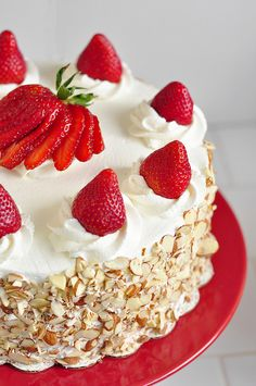 Scrumptious Strawberry Shortcake _ Cover the sides of the cake with sliced almonds. A multi-layered bonanza of a cake. Tons of whipped cream & fresh sliced strawberries!