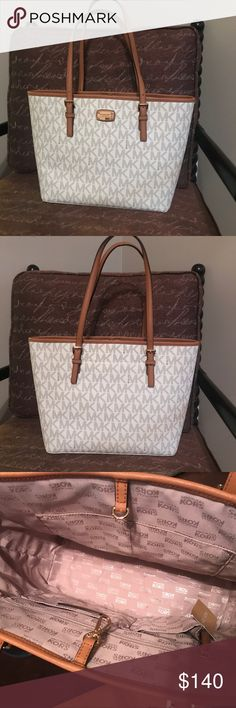 NEW Michael Kors Jet Set Vanilla Carryall Tote New with tags!  Michael Kors Jet Set Travel Vanilla Carryall Tote.   * 100% authentic  * Gold-Tone Hardware  * Lining 100% Polyester  * Interior : 1 Zip Pocket ,1 Cell Phone Pocket ,3 Open Pockets  * Handle Drop: 9'' * 16''L x ''10.5H x 4.5''D Michael Kors Bags Totes