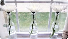 Love this so much - simple flowers in plain bottles.
