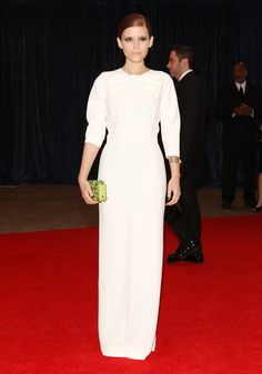 The Hollywood Crowd Wows at the White House Correspondents' Dinner: Kate Mara went the minimalist route in a white Prada gown with a pop of color via her lime green clutch.
