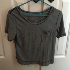 Black and white striped lulu lemon tshirt Skinny black and white stripes; never worn; raises in the back; pocket in the front of the shirt lululemon athletica Tops Tees - Short Sleeve