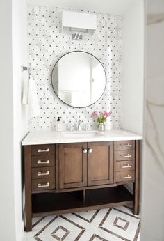 BATHROOM   Hall Bathroom Makeover. Beautiful small bathroom with accent tile in a warm toned marble with wood vanity and round mirror