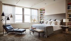Industrial Bedroom in New York, NY by Shawn Henderson Interior Design