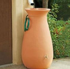 Beautifully terracotta rain catcher, or read to see how you can do a cheaper one yourself.