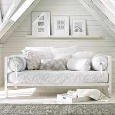 This proves that painting that attic white and adding a few sky lights can make a beautiful retreat for a lazy summer nap or a few extra guests. The textures add the necessary warmth and interest to the all white palette.