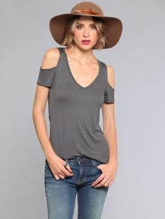 Super soft, cold shoulder tee featuring a soft v-neckline and cutout shoulders