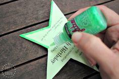 Adding glitter glue to fairy wand invitations