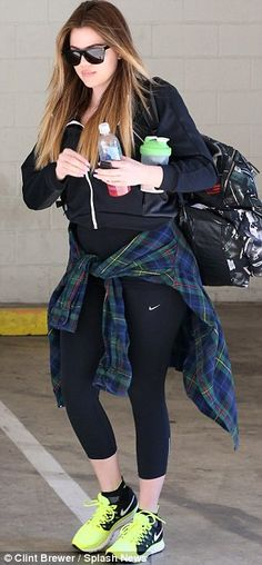 Grunge at the gym: She also tied a checked flannel around her waist as she sported a pair ...