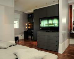 Um dúplex em preto e branco. Atmosfera masculina predomina em lar de fotógrafo
