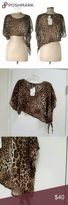 NWT LF Animal Print Leopard Crop Top Blouse Brand new with tags sheer cropped animal print blouse. Scoopneck. Asymmetrical hem. Side tie. Wear it out over your bra if you're daring or over a cami (if you're like me).?  100% Polyester. By Millau. SZ S. Retailed for at LF for $118.   If unfamiliar, LF is a cross between UO, Free People, & Brandy Melville.  Pls check out my closet for more NWT & LF items to bundle with discount and save more with combined shipping. LF Tops Crop Tops