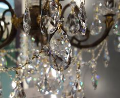 Did you know that the Romans believed that the fire and sparkle in a crystal jewel reflected the flame and romance of constant love? Crystal chandeliers now grace our modern interiors! Chandelier Centerpiece, Crystals Minerals, Lighting Design, Crystal Chandeliers, Sconces, Diamond Earrings, Sparkle, Gems, Romans