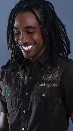 Locs. Locs?  He had me with the smile - gorgeous.  Where was he 23 years ago - a twinkle in his mother's eyes probably.