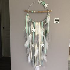 Dream catcher in driftwood and stars, in mint, gray and beige colors