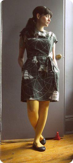 I love the gray print dress and mustard tights.