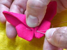 How to make a fabric origami butterfly - Mollie Makes - Ciandli Turn your cut-offs and fabric scraps into pretty origami butterflies Origami Rose, Fabric Origami, Origami Butterfly, Origami Flowers, Origami Art, Fabric Butterfly Diy, Butterfly Crafts, Fabric Flowers, How To Make Butterfly