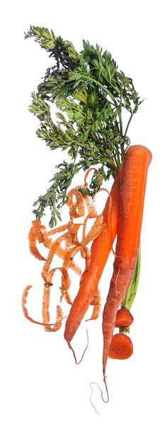 How do you make the most of your food? You eat the whole carrot from the green tops to the peels. Click the link to find more ways to reduce food waste. (Photo: Tony Cenicola/The New York Times)