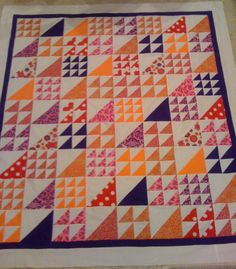 Love the different sizes of half square triangles. I was going to make a play quilt for our new grandson (to be) all one size, but I will try this instead.