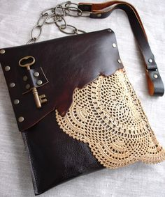 Leather... lace... key... studs... Disparate elements merge for an outstanding bag by Urban Heirlooms