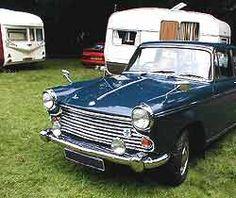 A BMC Morris Oxford on a caravan club stand.