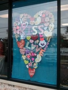 "Easily done Valentine's Day window display. Scrapbook papers, and tip from http://TGtbT.com, Too Good to be Threw: ""use adhesive dots to apply to your window rather than tape: much neater-looking!"""
