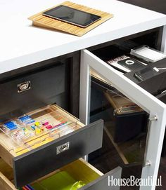 these drawers have been outfitted by the container store with modem wifi router recharging