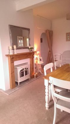 My dining room with my lovely cream electric log burner. Sally My dining room with my lovely cream e Wooden Fireplace Surround, Faux Fireplace Mantels, Fireplace Surrounds, Fireplaces, Electric Log Burner, Electric Fires, Lounge Decor, Cosy Lounge, Lounge Ideas