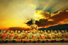 Golden buddha statue in buddhism temple thailand against dramati Stock Photography