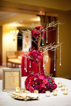 Centerpiece-I like this idea for the entrance table to hold the 'kissing' bells