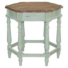 Bring a touch of rustic appeal to your living room or den with this lovely end table, showcasing a hexagonal silhouette and turned legs.      ...