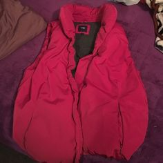 Pink Vest From gap. Can fit a medium. Its more on the puffy side but super warm. GAP Jackets & Coats Vests