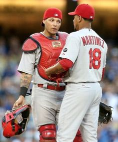 Molina and Martinez- I love the look on Yadi's face.
