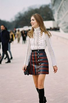 button up striped leather skirt, high necked white lace top, knee high boots. Street style // 2017 trends // women's fashion Vanessa Jackman