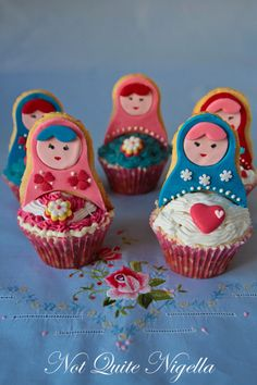 Babushka cupcakes. I don't have the skills to pull this off, but I want them. Better get into the kitchen and start trying...